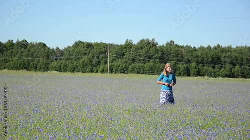 girl walking ease meadow cornflower picked small flower blossom