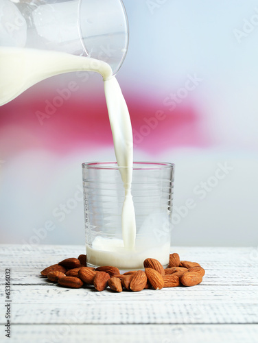 Almond milk is poured into glass,