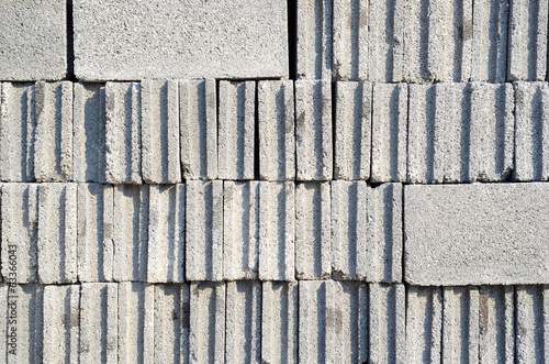 Cement bricks stacked in piles at construction site