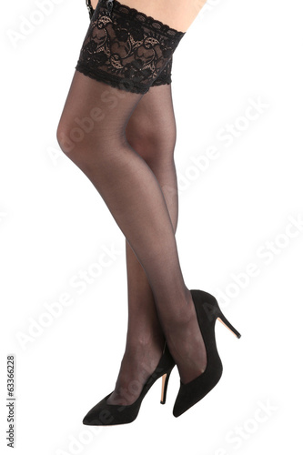 Stockings on perfect woman legs, isolated on white