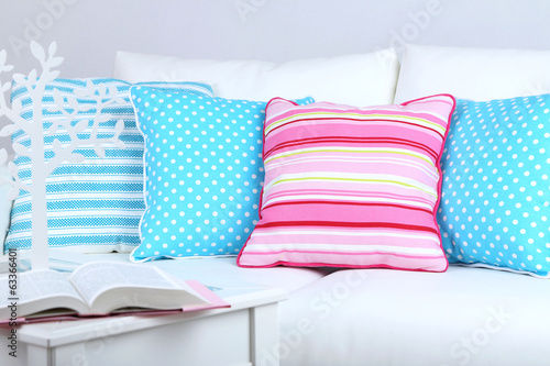 White sofa with colorful pillows in room