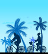 Couple bike ride on the beach silhouette