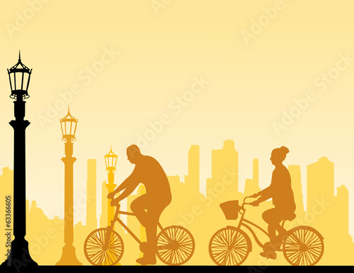 Couple bike ride on the street silhouette