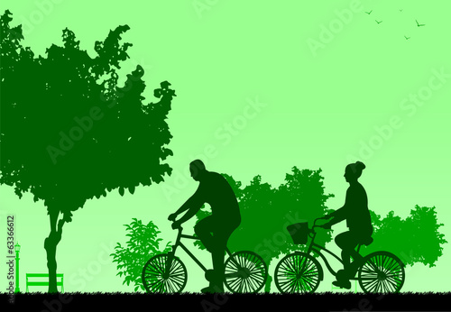 Couple bike ride in park in spring silhouette