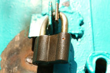 Old padlock on door, close up