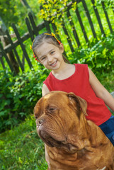 young girl and mastiff