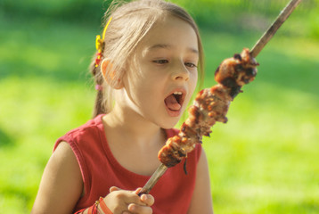 young girl eats kebab