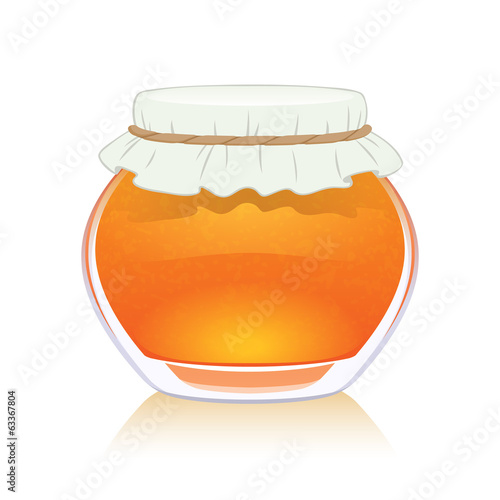 Orange jam in glass jar.