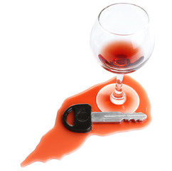 Composition with car key and glass of wine, isolated on white