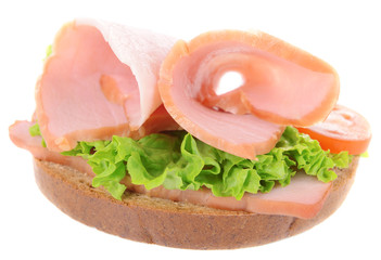 Delicious sandwich with lettuce and ham isolated on white