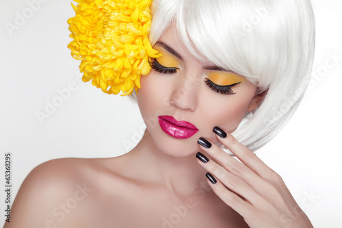 Beauty Blond Female Portrait with yellow flower. Beautiful Spa W