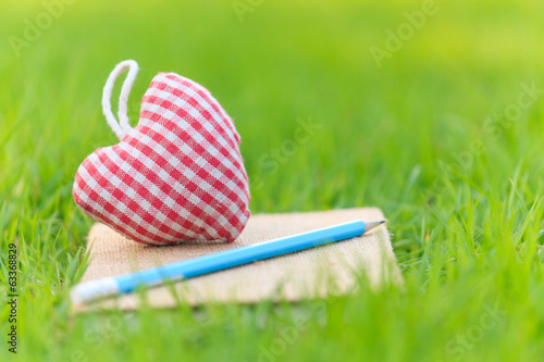 Fabric heart on diary