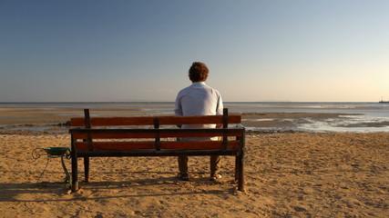 Man sitting alone on the beach