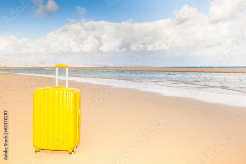 yellow trunk at the beach