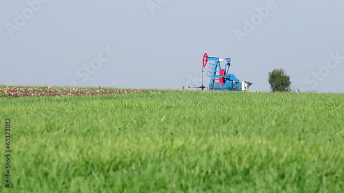 oil pump jack on field