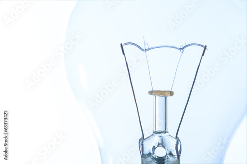 Light bulb macro with the filament wire and construction artisti