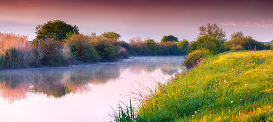 Colorful summer panorama of the river