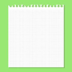 White piece of paper on a green