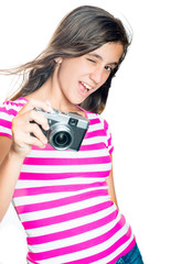 Trendy and funny young girl holding a compact camera