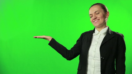 Young businesswoman presenting on green screen