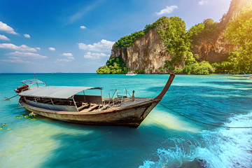 Long boat and rocks. Railay beach in Krabi