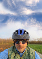 blue sky and cyclist