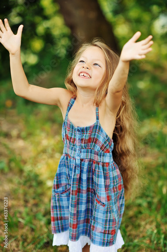 Happy little girl having fun outdoors