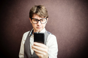 Funny guy using mobile smartphone