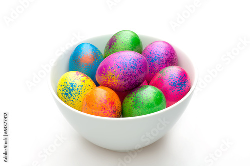 Colored eggs in bowl