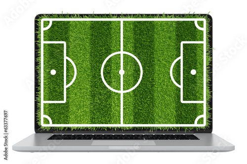 Modern laptop. football lawn grass