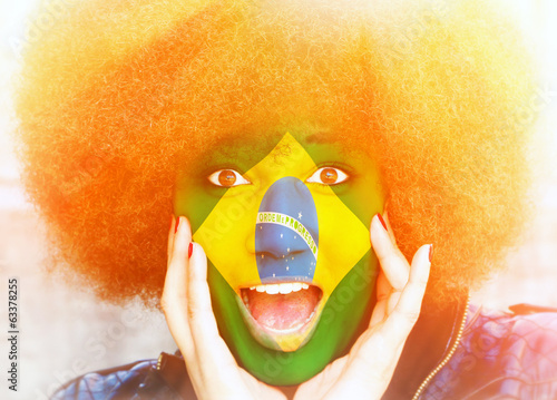 canvas print picture Girl with brasilian colors in face - soccer fan in sunny stadium
