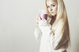 Beautiful blond woman with Coffee.Vapor Cup of tea. Hot drink