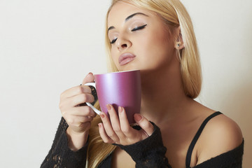 Beautiful blond woman drinking Coffee. Cup of tea.Delicious