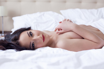 Hot brunette posing lying down looking at camera
