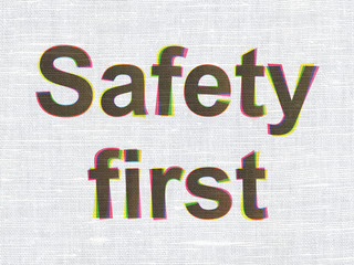 Protection concept: Safety First on fabric texture background