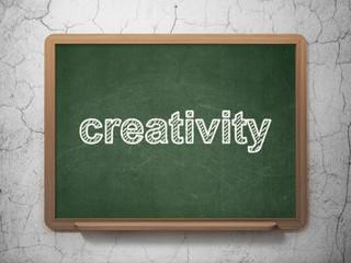 Marketing concept: Creativity on chalkboard background