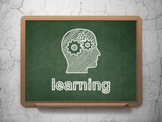 Education concept: Head With Gears and Learning on chalkboard