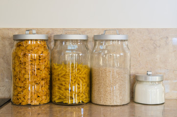 Glass jars with pasta and rice