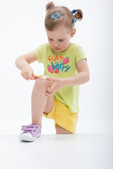 Little girl with plaster on knee