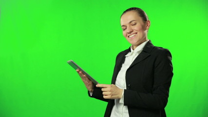 Cheerful businesswoman working on tablet computer