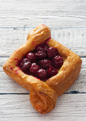 Cake of puff pastry with cherries