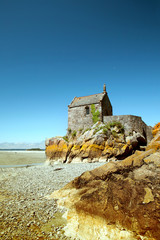 The small building on sea brink in low tide, Mont St Michel