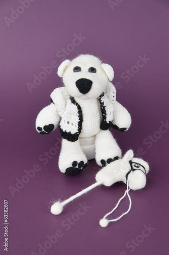 Toy white teddy in a gift