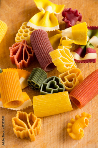 Multicolored italian pasta, vertical background