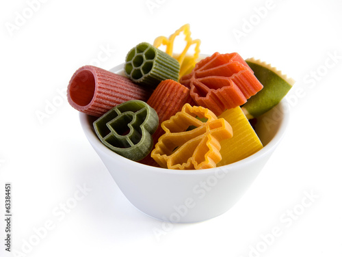 Multicolored italian pasta in bowl