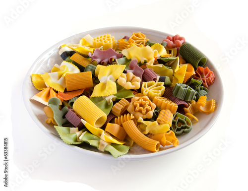 Multicolored italian pasta in plate, isolated