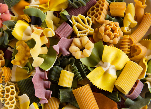 Multicolored italian pasta, horizontal background
