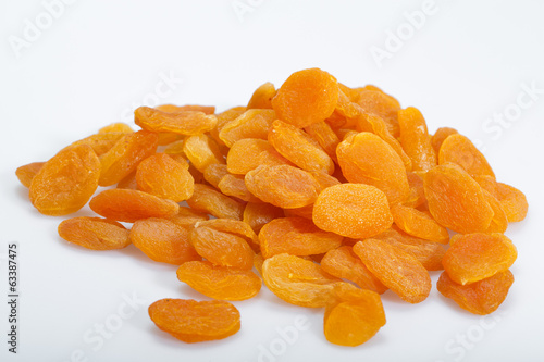 A heap of dried apricots on a white background