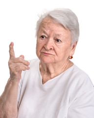 Old woman in angry gesture