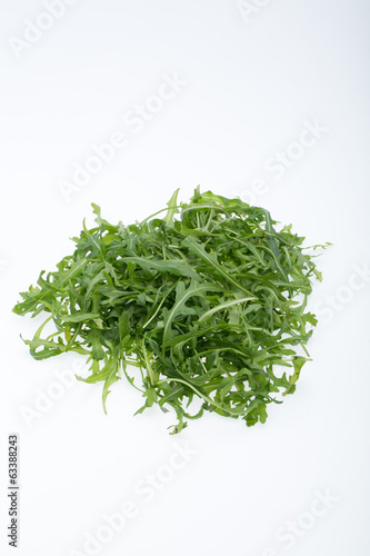 Heap of ruccola leaves isolated on white background